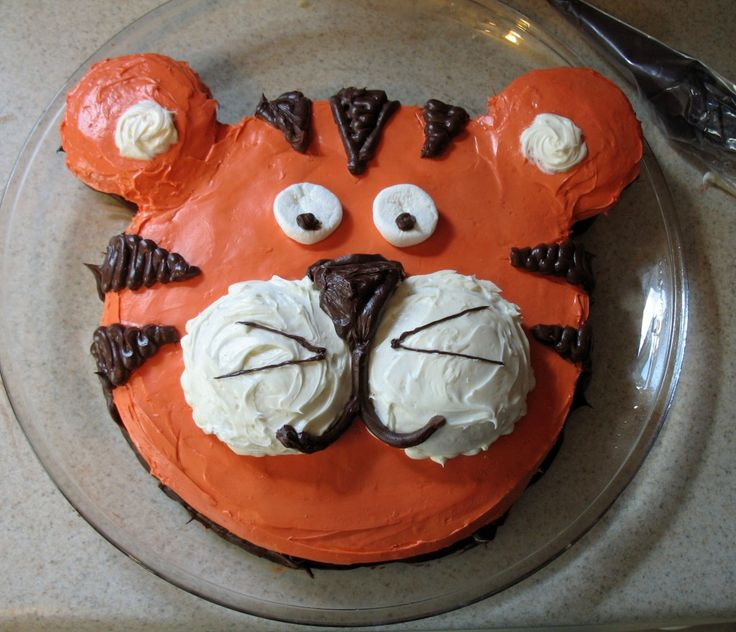 """Tiger Cake for cake walk.  1 9"""" cake, 2 cupcakes for ears, 2 cupcake tops for cheeks."""
