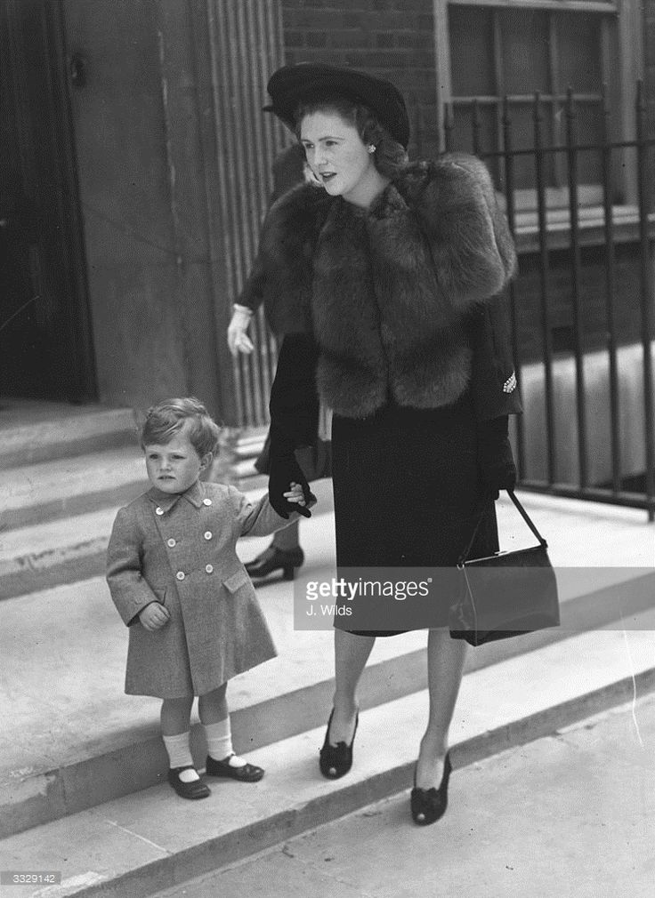 Politician Winston Churchill (grandson of prime minister Sir Winston Churchill) leaves home with his mother Pamela Churchill (nee Harriman). Young Winston is acting as a page to Lady Sarah Churchill at her wedding.