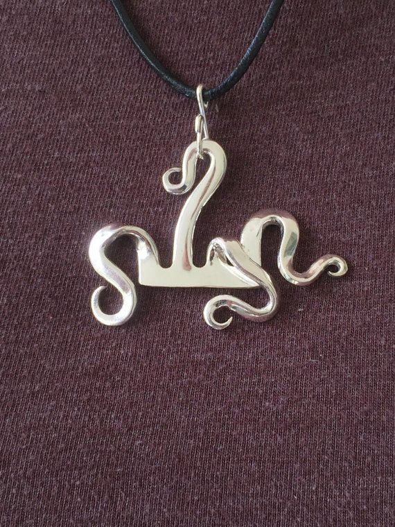 This fanciful fork pendant twists and turns and its unique design allows the wearer to attach the pendant in different ways. Just open up