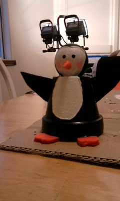 Terracotta Penguin Pot  Used: Acrylic paint, clear coat spray paint, wooden ball (for head), foam, puff paint.