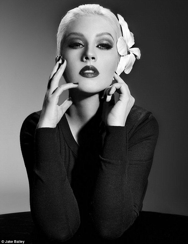 Retro glamour: Christina Aguilera delivers an alluring gaze in this promotional shot for her forthcoming LP