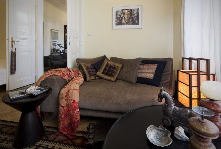 Italian sofa with collection of indian artistic pieces.