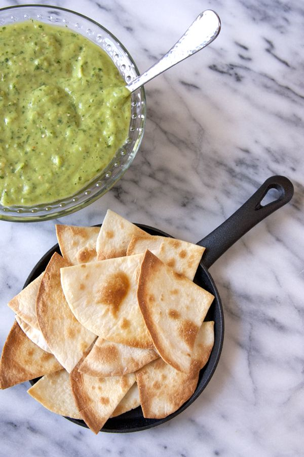 Avocado and Tomatillo Green Chile Salsa + Baked Flour Tortilla Chips - Muy Bueno Cookbook  These warm and crunchy tortilla chips combined with this delicious and easy to make no-cook salsa is quite addictive. This salsa reminds me of a salsa I first tasted it in Ixtapa, Mexico. The creaminess of the avocados combined with the pop of spice from the chile makes this salsa irresistible.  Once you have this salsa made you can eat it for breakfast, lunch, and dinner.
