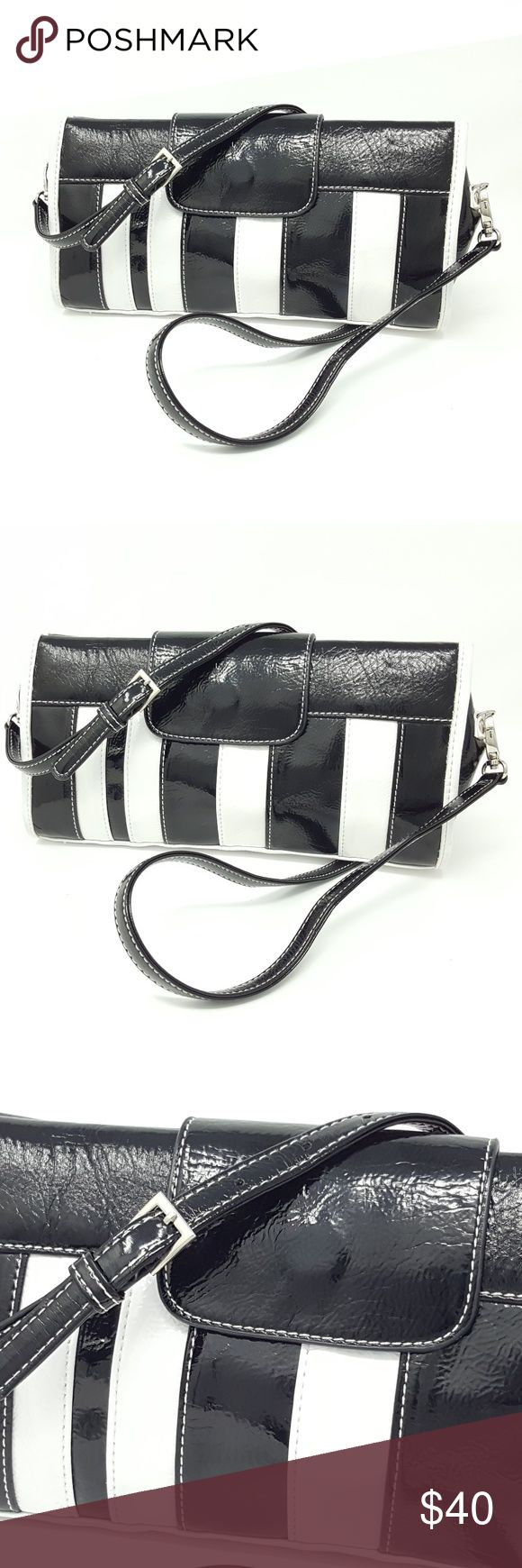 Aldo Black White Soft Crossbody Bag | Clutch Purse Aldo Black & White Soft Shoulder Bag.  Magnetic closure.  Interior is black with a slip in pocket.  Bag is in good condition (see photos).  Enjoy this black and white crossbody bag and feel good ethical fashion by rescuing a vintage item from the landfill.    This item is PRE-OWNED. Aldo Bags Crossbody Bags