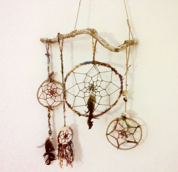 This dreamcatcher is a made to order item, and each is an original item. Materials include: - driftwood hanger - sustainably sourced coloured thread from Nepal - hemp string and twine - feathers and beads - pliable metal for the rings *no suede or leather included in these dreamcatchers, trying to keep it ethical  If youd like one, it will be original and Ill design it to suit the driftwood features. Can be shipped nationally or local pickup.  Its always a good idea to include something…