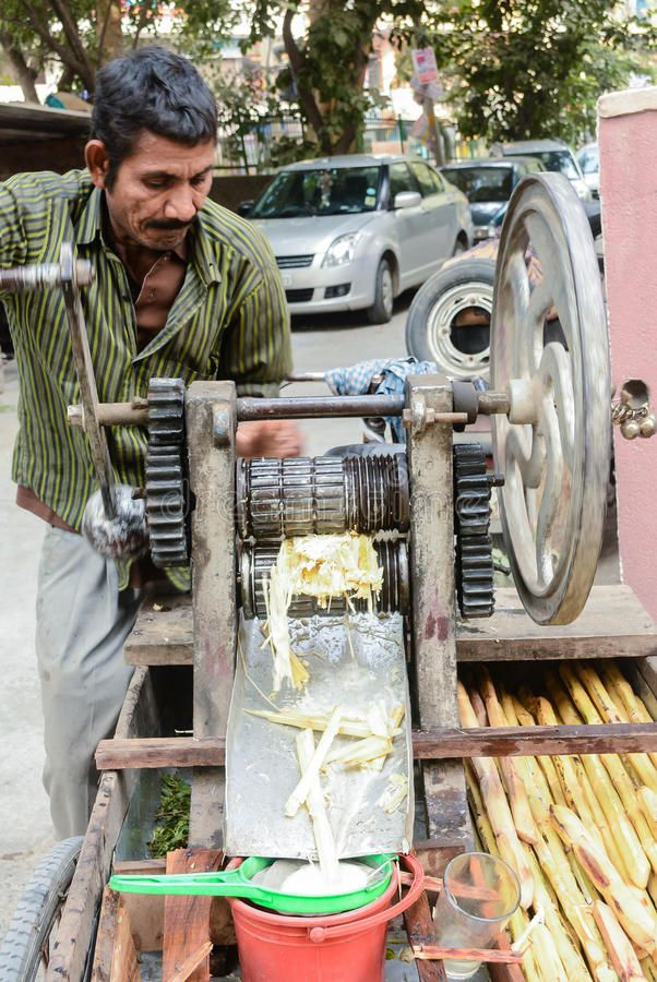 Man Selling Sugarcane Juice A Street Vendor Using The Sugarcane Press To Extrac Ad Juice Street Sugarcane Man Sel Sugarcane Juice Sugarcane Juice