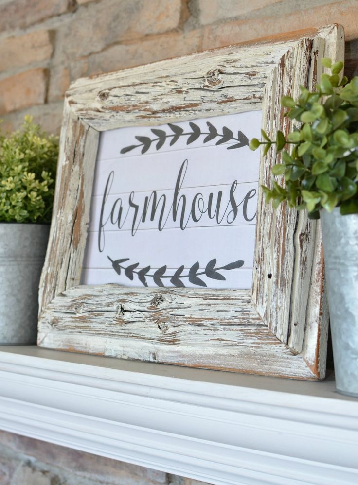 Simple Farmhouse Mantel styled with old books and greenery. Plus a free farmhouse printable!