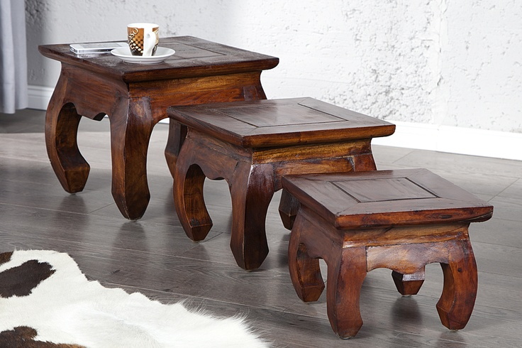 """Dieser formschönen massiven Couchtische """"OPIUM"""" sind die idealen Tische für Ihr Wohnambiente. Die Beistelltische vermitteln ein rustikales Urlaubsflair und überzeugen durch ihr naturbelassenes und klares Design. Zu einem charakteristischen Blickfang werden die im asiatischen Stil geschwungenen Beine. Die großzügigen Ablageflächen wirken zudem nie überladen und unterstreichen dadurch zusätzlich den luxuriösen Auftritt dieser Couchtische."""
