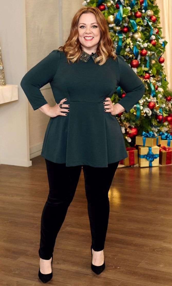 Melissa McCarthy in a dark green top and skinny black pants - click through to see more celebrity winter outfits