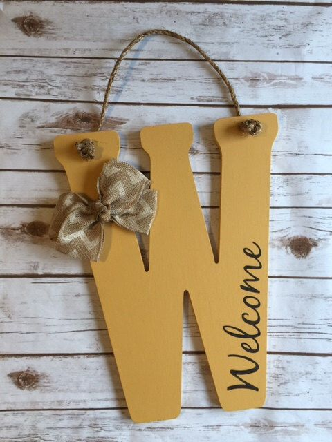Wooden Front Door Letter Hanger - Rope or Ribbon Holder - Welcome Sign - Front Porch Decor - Wreath Monogram Letter - Accent Flowers by SouthernStyleDecor1 on Etsy https://www.etsy.com/listing/239179170/wooden-front-door-letter-hanger-rope-or