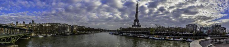 Panorama of Paris - Paris, 2016.04.08 This panoramic picture of Bir Hakeim Bridge, Seine River and Eiffel Tower has been created by merging six photos in Adobe Lightroom.