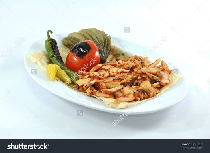 Doner kebab isolated on white background.doner, shawarma, kebab, chicken, turkey, meal, lettuce, gyro, porsiyon, turkish, wrap, snack, slices, donner, salad, roasted, dinner, pita, bread, food, sauce, takeaway, isolated, roll, beef, white, lamb, tomato, sandwich, tavuk, halal, meat, fast