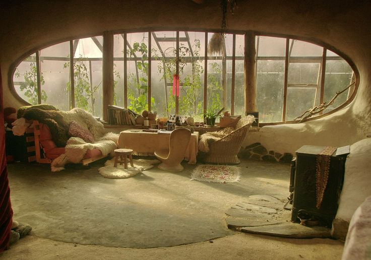 hobbit style living room - love the idea of having a window into the greenhouse - bring in tonnes of green tinted light.