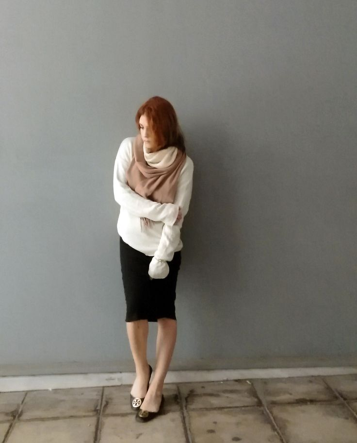 Layering knitwear in neutral shades and soft shapes. Read the post on www.chelf.net