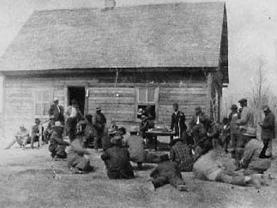 Meeting to settle church argument in Arbakka Manitoba in 1916. Gorash Kosowan is the speaker.