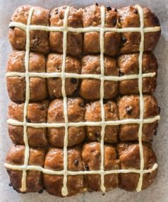These fruity, gently spiced buns are simple to make and will win you serious brownie points.