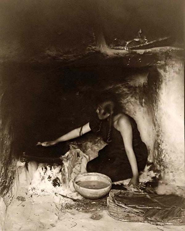 Here we present a rare image of Piki Maker. It was taken in 1906 by Edward S. Curtis.    The image shows a Hopi Indian woman making bread inside pueblo.