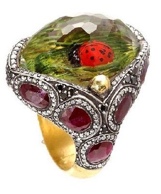 amazing Sevan Bicakci ring. he carves these designs inside the stone.