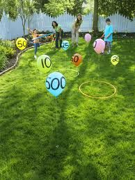 Party goers toss a hoola hoop around the balloons to earn points for a prize.
