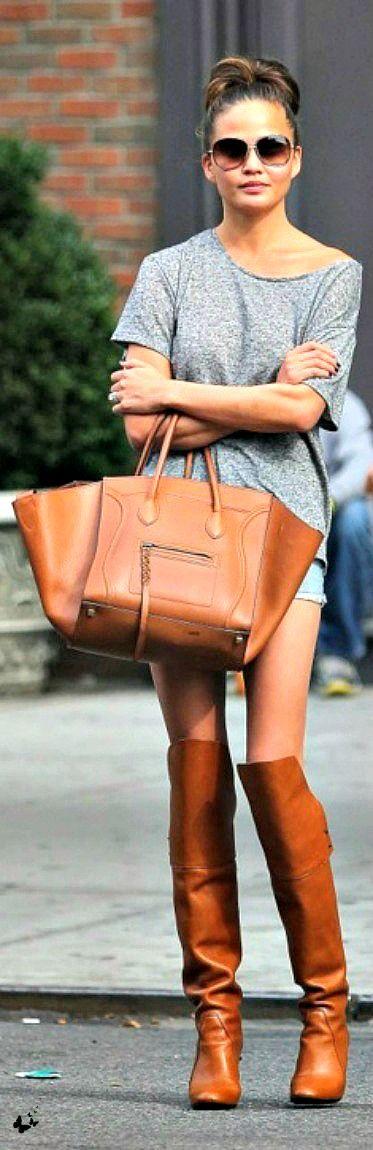 Chrissy Teigen grey dress with Steve Martin boots tan with skinny legs