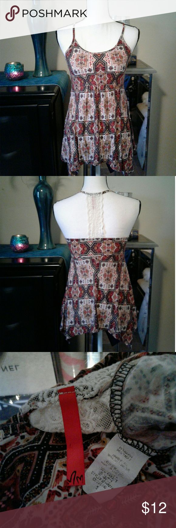 """Lace back tribal asymmetrical tank top Women's very gently pre loved brown/red multicolored tribal asymmetrical tank top with lace detail on back. Size Small. Measurements Chest 13"""" length 22"""". Thanks for looking Bundle to save!! Tops Tank Tops"""
