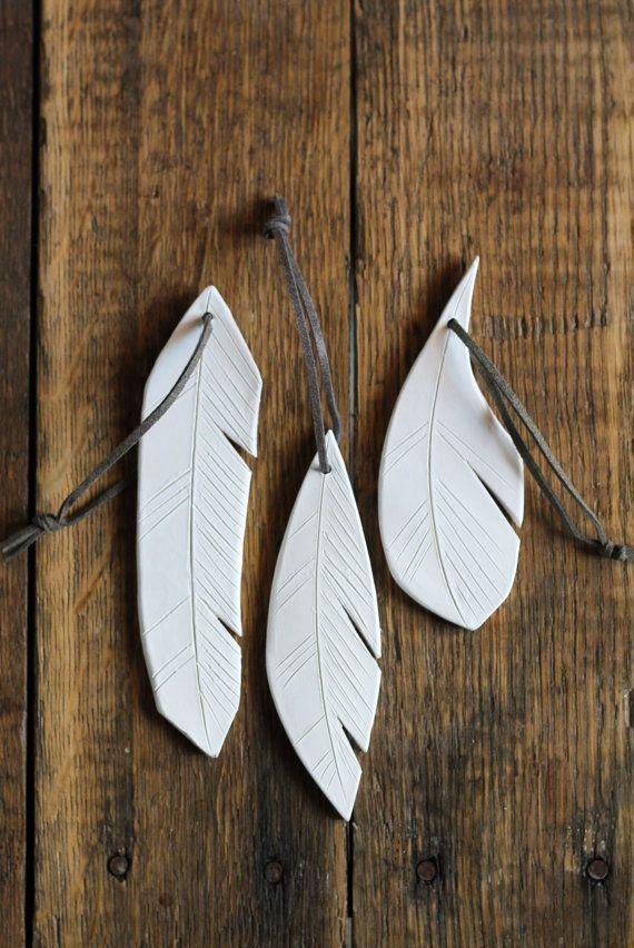 white ceramic feather ornaments