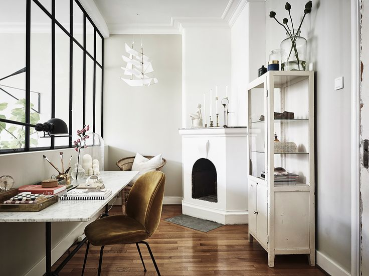 in LOVE with every little element in this sweet home office where the light comes flooding in from those indoor windows...