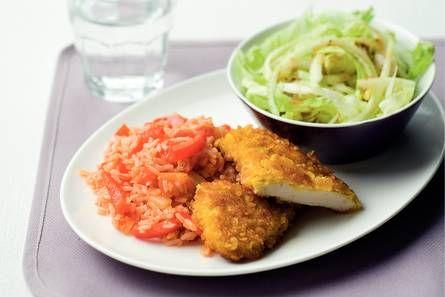 Krokante kipschnitzels met tomaten-paprikarijst