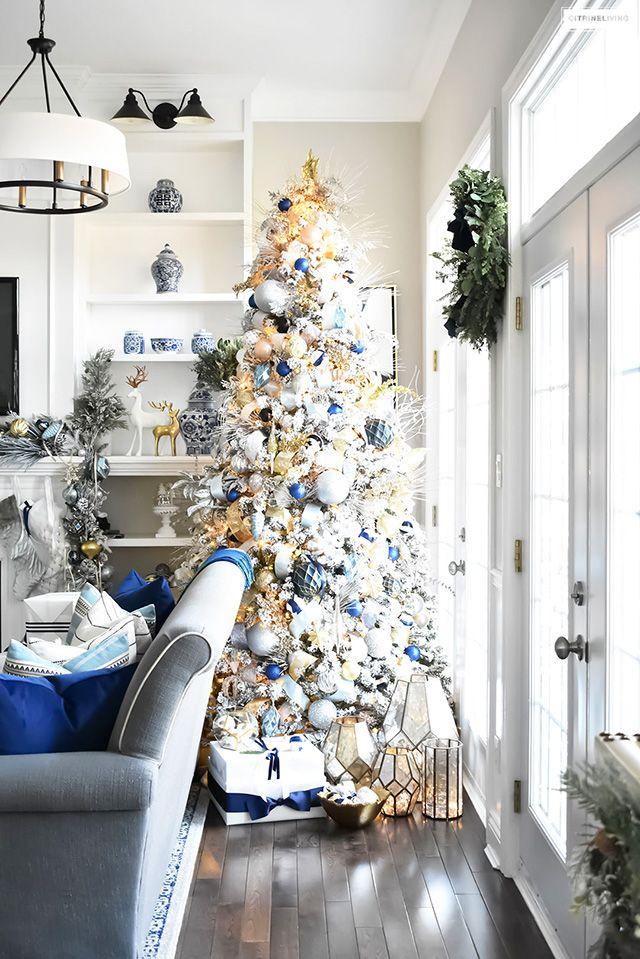 Flocked Christmas Tree Decor Blue Silver Gold Citrineliving Blue Christmas Decor Gold Christmas Decorations White Christmas Tree Decorations