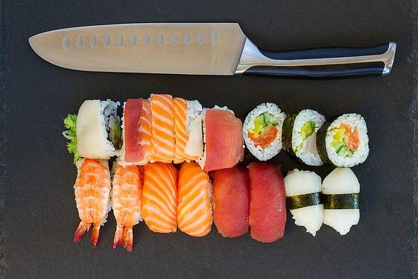 Lunch with japaneese nigiri and roll sushi dish with knife by Anastasy Yarmolovich #AnastasyYarmolovichFineArtPhotography  #ArtForHome #Food