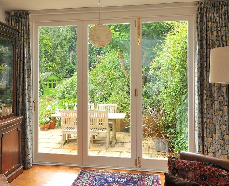 New bespoke timber bi-fold door, interior view, manufactured and installed by The Sash Window Workshop