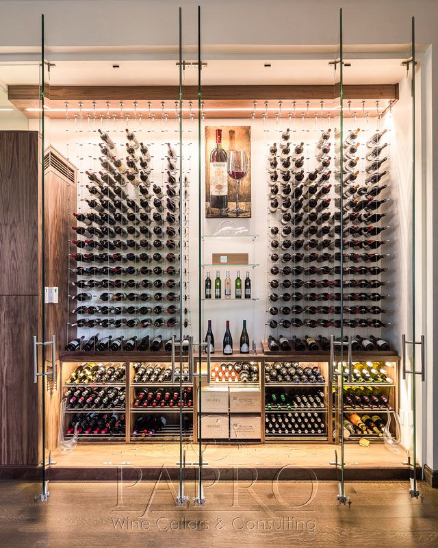 Modern wine cellar featuring the Cable Wine System by Papro Consulting