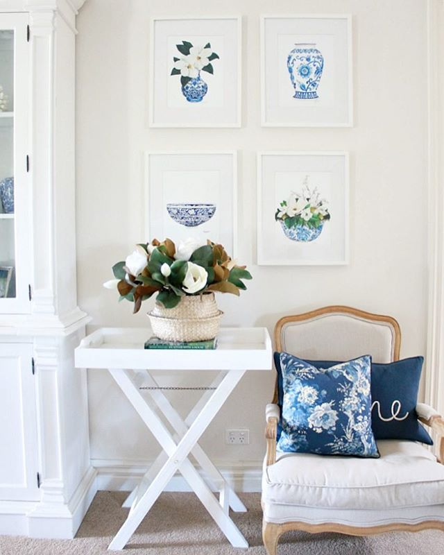 Blue and white living room, Artwork by Sprout Gallery.