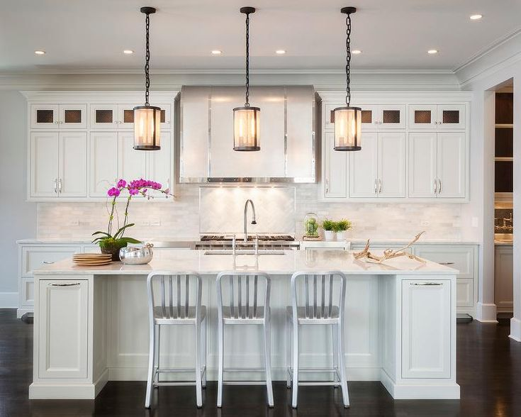 Three Restoration Hardware Riveted Mesh Pendants Illuminate A White Kitchen Island Topped With