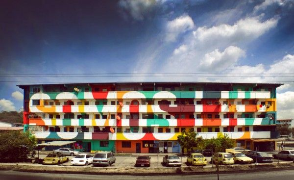 "To enhance one such building in the neighborhood of El Chorrillo in Panama City, Spanish urban art collective Boa Mistura painted the facade of the housing block to convey the message ""somos luz"" (translated as ""we are light""), using a vibrant polychrome scheme to not only beautify the formerly drab, gray exterior"