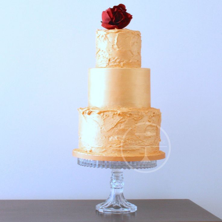 Design suppled by client.  A rough iced finish with painted gold.  Single dark red sugar peony adorns the top.