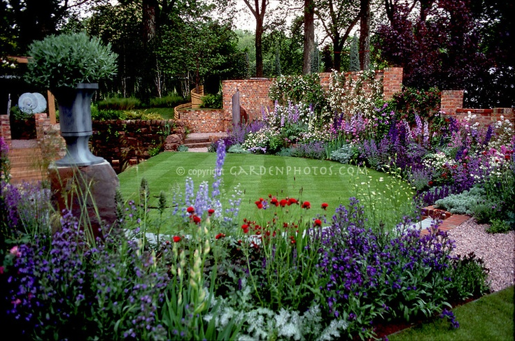 Glorious upscale garden with lots of flowers in blue and purple color theme, in mathematical proportions Design: Xa Tollemache & Jon Kellett