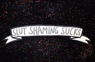 """Women don't owe you shit"" and ""Slut shaming sucks"" banner stickers 