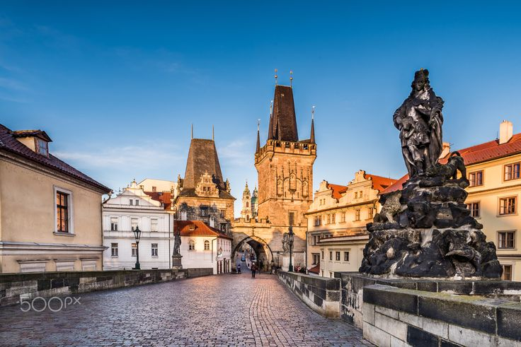 Morning on the bridge - Morning view of Lesser town bridge towers at the entrance to Charles bridge in Prague.