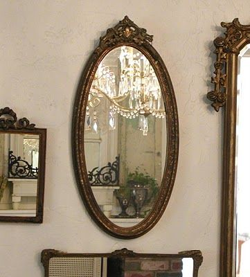 wall of vintage mirrors