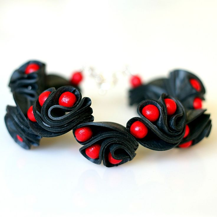 Dragoneye bracelet, red via ACCE, 45 €. Click on the image to see more!