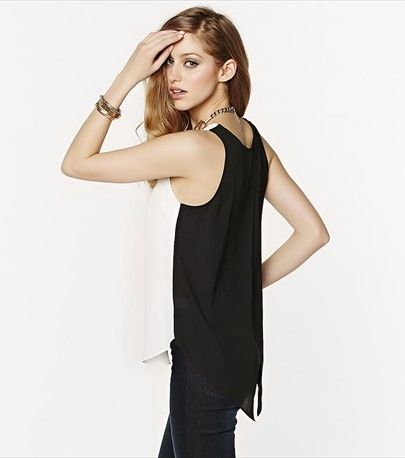 This chic black & white tank features a sexy cross over back! Pair it with jeans for a casual night out.