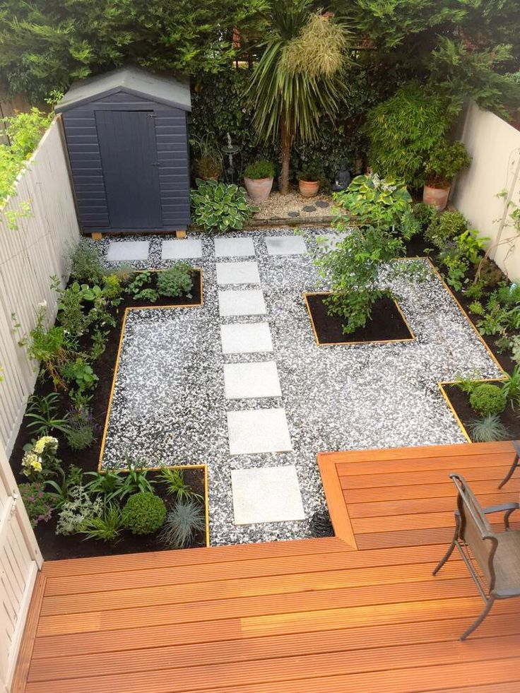 New Garden design project in Sunbury. Decking area with granite path and grey and white gravel . gdndesign.com