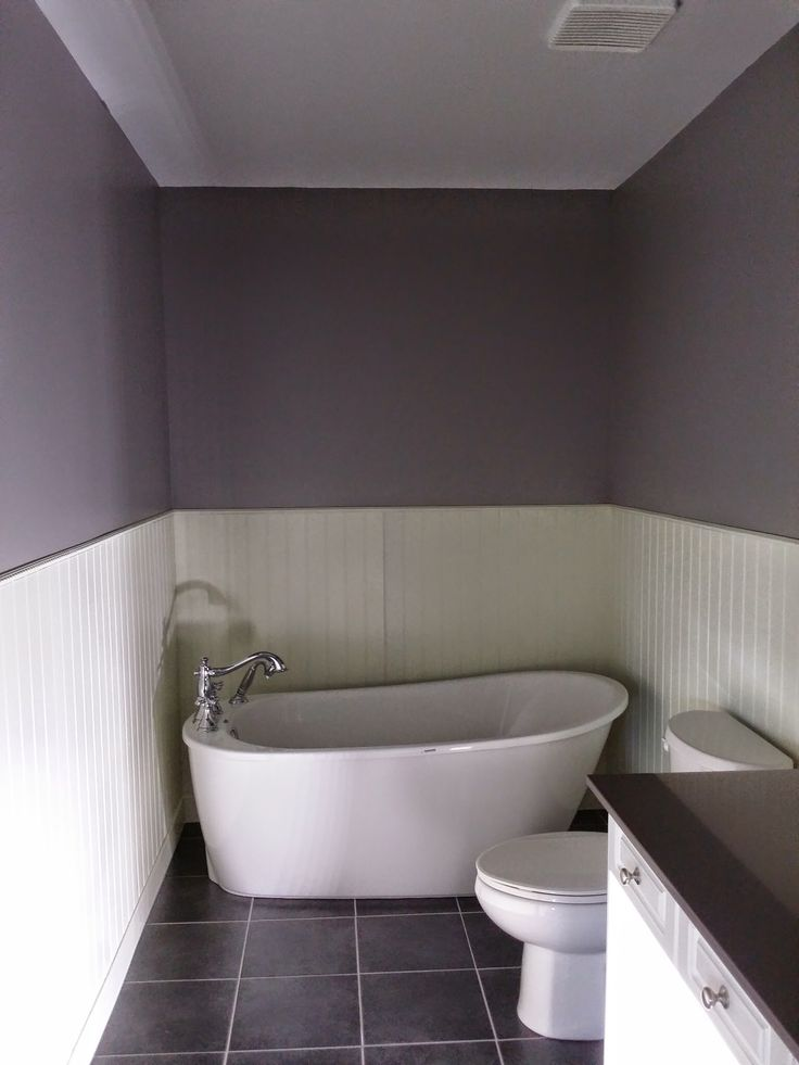This is a free standing tub that we installed on this renovation with a deck mounted faucet including wand wash.