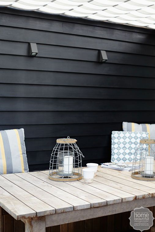 French affair: the home's weatherboards were stained with Porter's Paints Palm Beach Black.