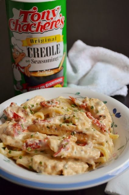 Creamy Cajun Pasta 4 oz. linguine noodles    1/4 c. olive oil 1 tbsp. garlic (optional) 1 tsp. red pepper flakes (optional) 3 tbsp. + 1 tsp. flour 1 1/2 c. heavy cream (milk) 1 c. Parmesan cheese (or other shredded cheese) Salt and pepper to taste 1 tbsp. Cajun seasoning* 8 oz. cooked chicken strips or 1 1/2 chicken breasts (I used Tyson's Grilled Chicken Strips) 1.5 oz of diced sun dried tomatoes 1 diced green onion