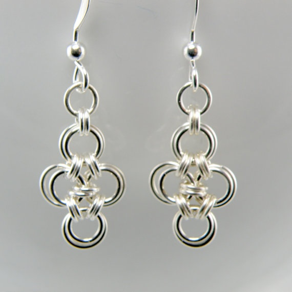 Chain mail earrings - maybe with some colored beads dangling from it.