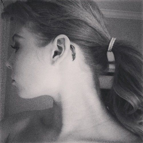 48 Marvellous Neck Tattoo Ideas For Bold And Brave Girls: #Feather #Tattoo #Neck