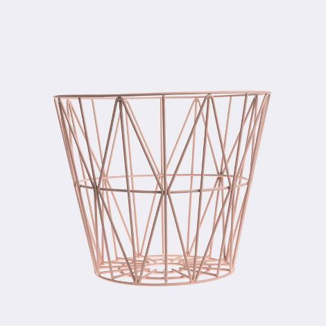Use this rose gold wire basket for extra storage, or flip it over add a top and make it a table, if you're feeling super creative try it as a lampshade!