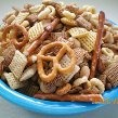 Crispix Snack Mix:   3 T butter  1/4 t garlic powder  1/4 t onion powder  2 t lemon juice  4 t Worcestershire sauce  7 c Crispix cereal  1 c unsalted nuts  1 c pretzels  Preheat oven to 250°F.  Melt butter in 9x13-inch pan in oven. Remove from oven and stir in garlic powder, onion powder, lemon juice, and Worcestershire sauce.  Add cereal, nuts, and pretzels stirring until coated.  Bake for 45 minutes, stirring every 15 minutes. Spread on absorbent paper to cool.
